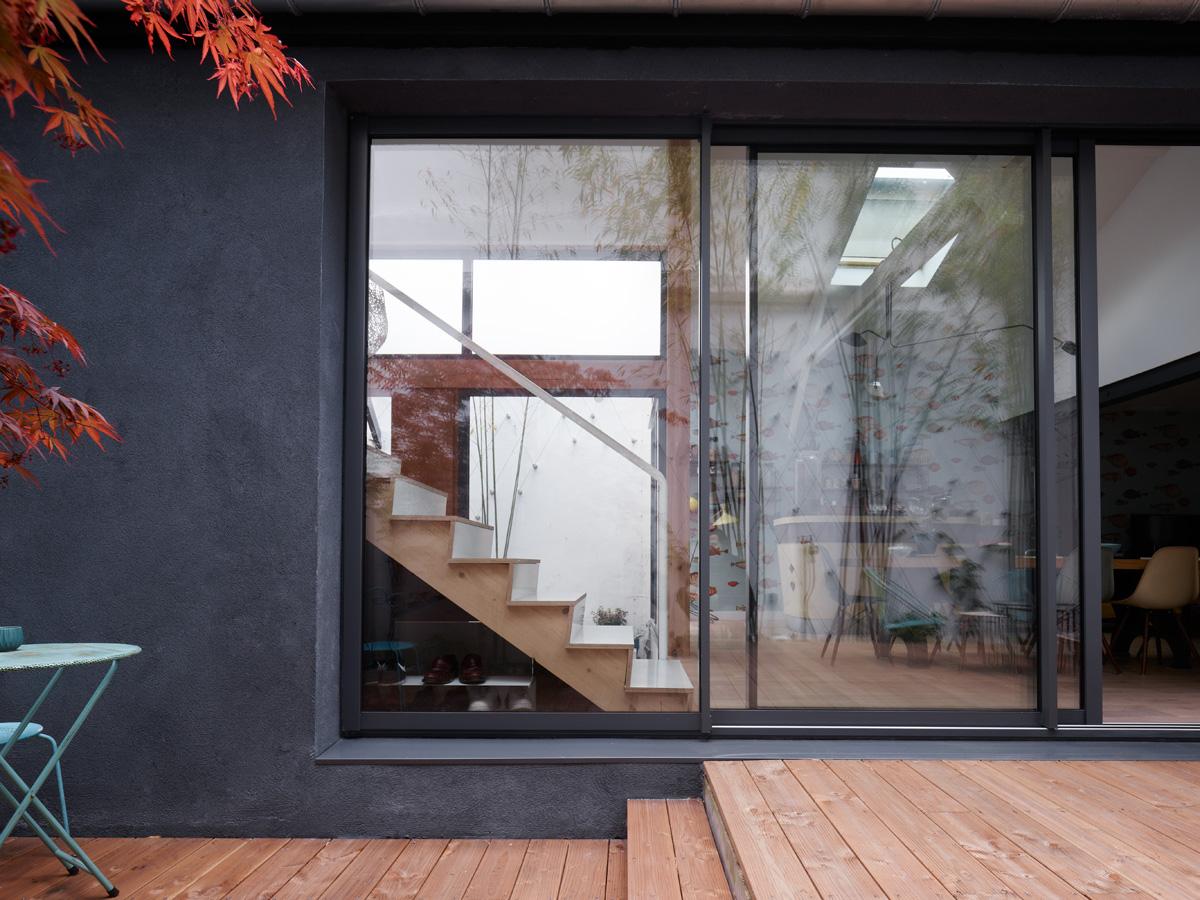 Construction maison de ville : baies vitrées sur cour